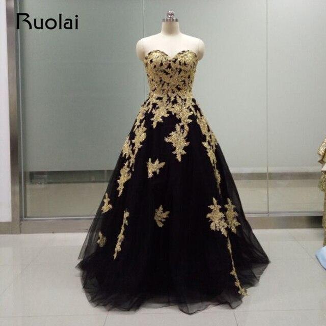 Abendkleider lang schwarz gold