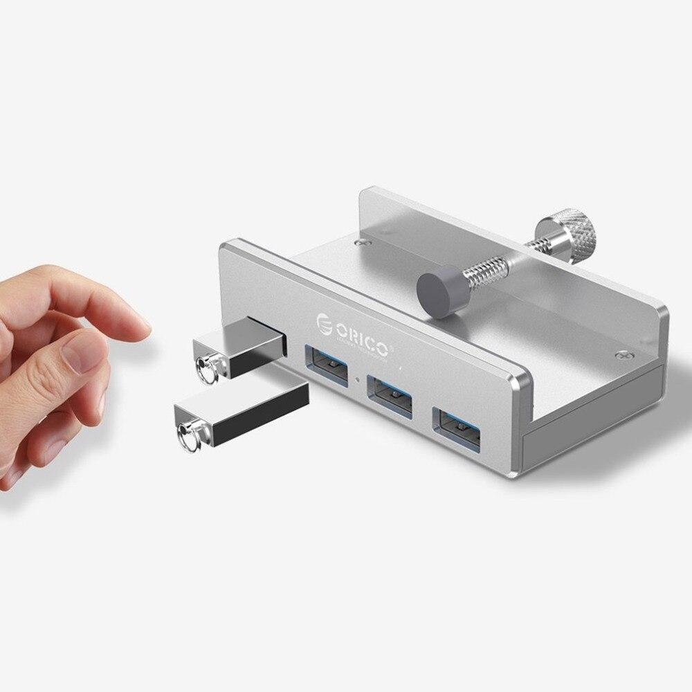 Orico 4 Ports USB 3.0 conception de Clip de moyeu en alliage d'aluminium Clip-type Portable taille chargeur de voyage Station de moyeu de charge pour ordinateur Portable