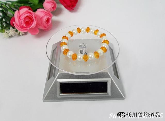 free shipping silver SOLAR AAA battery 2-way powered jewelry watch phone rotating display stand holder
