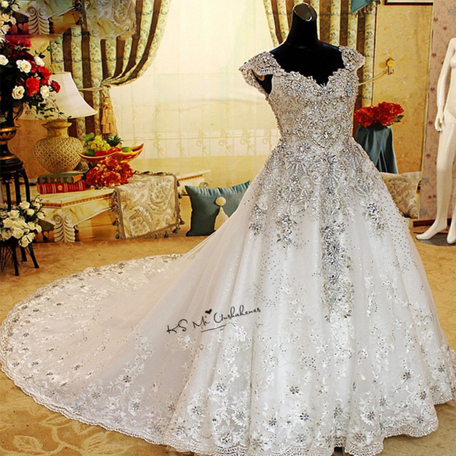 Rhinestones Luxury Wedding Dresses 2018 Sparky Ball Gown Crystals Wedding  Gowns Cap Sleeve Sequins Lace Bride c8e9452bb8fb