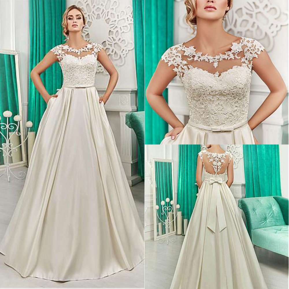 Charming A-Line Wedding Dresses Sleeveless O-Neck See Through Back Floor Length Bridal Gowns Bridal Dresses Classic Vestidos