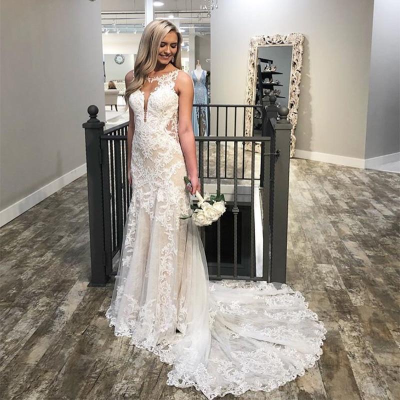 Sexy Jewel Neckline Mermaid Wedding Dresses Ivory Lace Appliques Champagne Lining Sleeveless Backless Vestido Novia Bridal Gowns