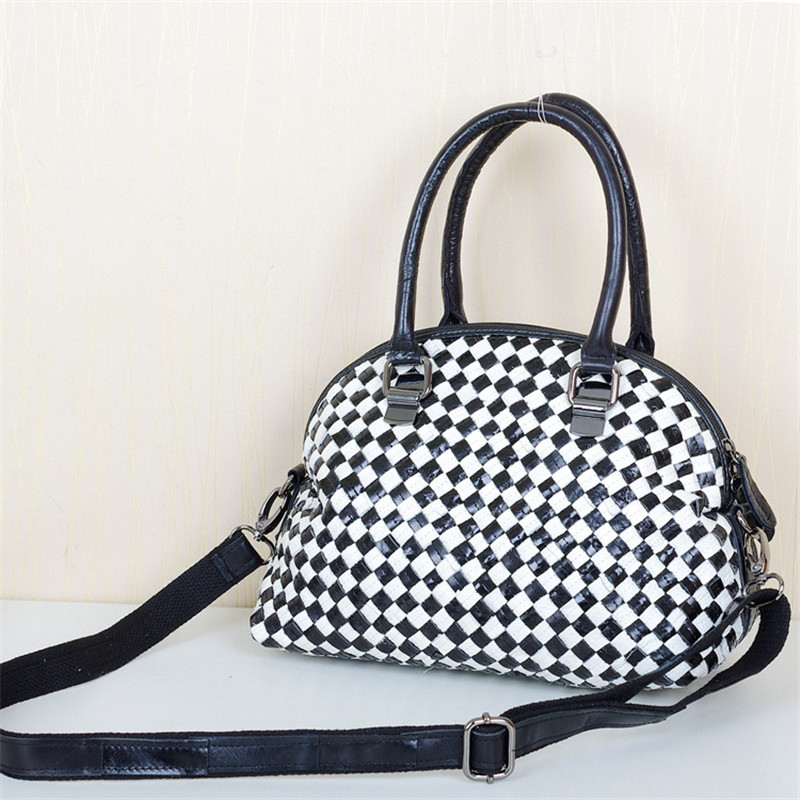 Caerlif New leather fashion black and white woven bags leisure pimp splicing lady s portable worn
