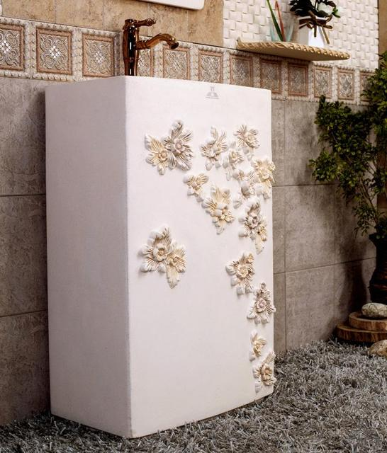 European rural lavabo. Flowers of carve patterns or designs on woodwork pillar basin. The balcony outdoor pool that wash a face