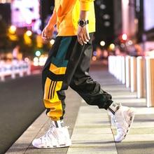 Calças de moletom dos homens casuais listrado moda solta calças de pista calças de suor esportes streetwear japonês branco preto