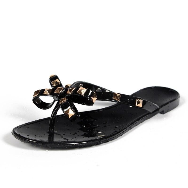Chaude 2017 Mode Femme Flip Flops Chaussures D'été Cool Plage Rivets grand arc plat sandales Marque de gelée chaussures sandales filles taille 36-40