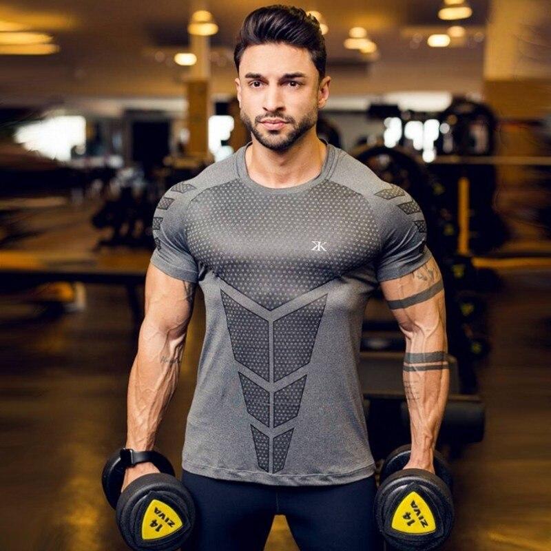 Carga Superman Rashgard hombre camisa de manga corta de los hombres camisetas de fútbol de los hombres medias de compresión Fitness deportes desgaste 2019