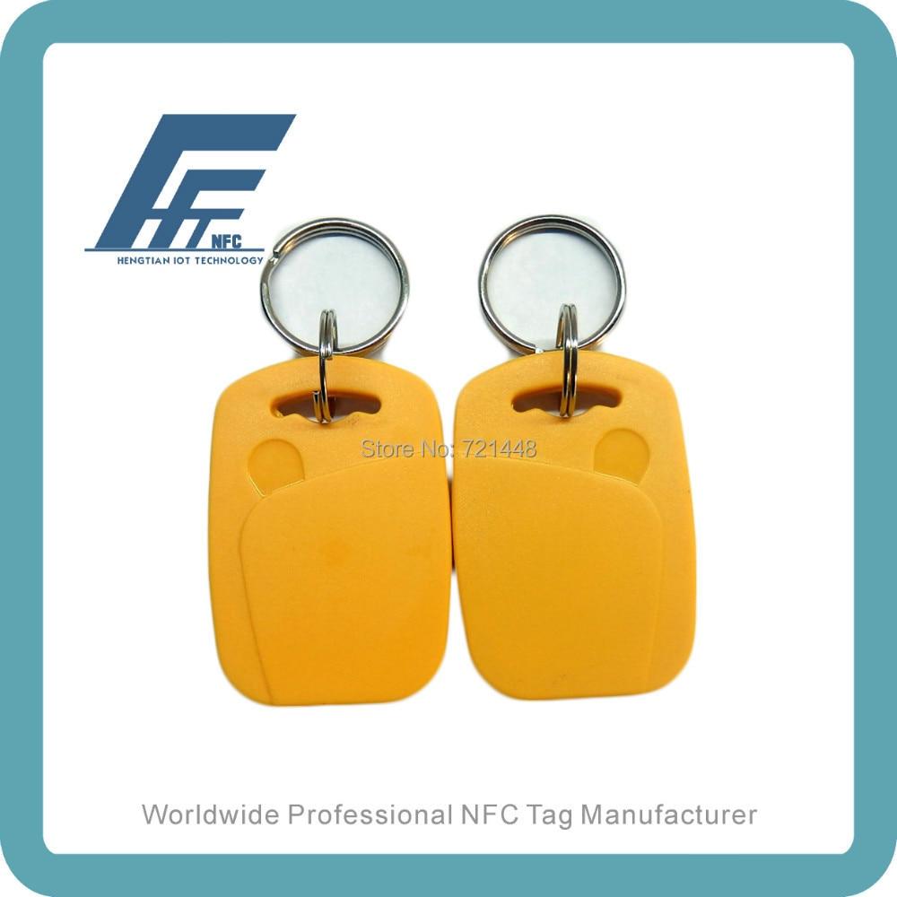 100 unids NFC keyfobs etiqueta impermeable amarillo disponibles para todos los teléfonos NFC Ntag213 NFC llaveros
