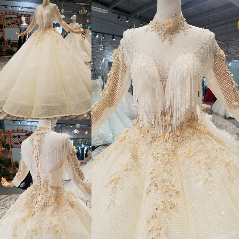Luxurious Illusion Wedding Dress Sheer Sexy Appliques Beads Lace Big
