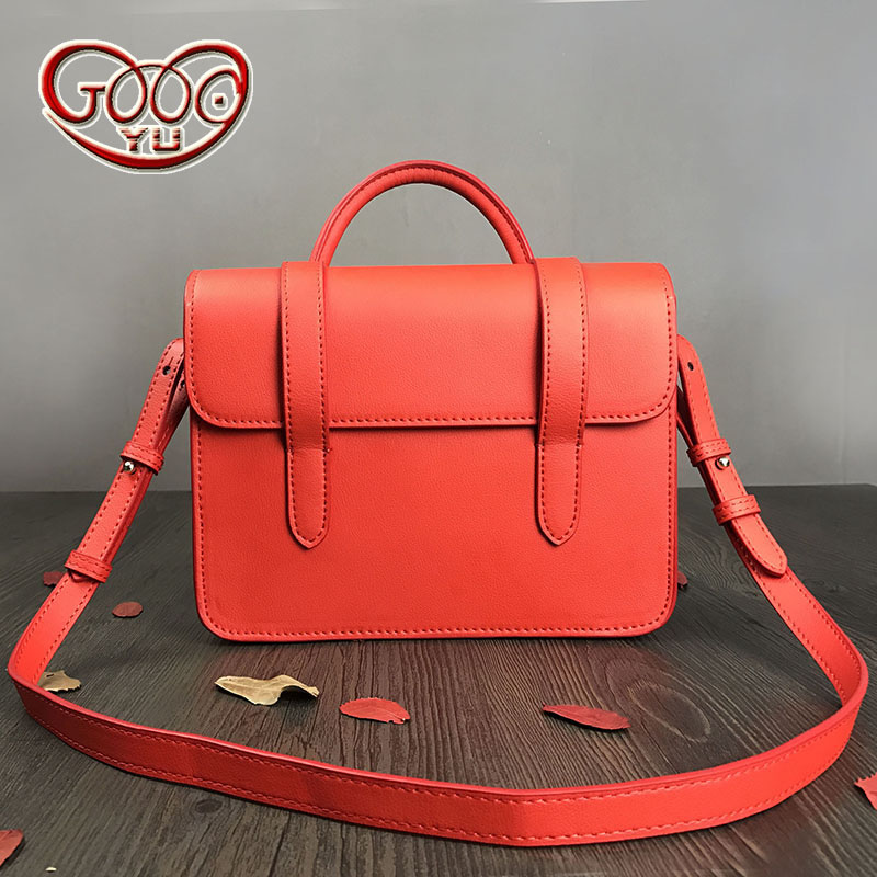 Europe and the United States style new solid color female first layer of leather wrapped around the shoulder Messenger bag europe and the united states style first layer of leather lychee handbag fashion retro large capacity solid business travel bus