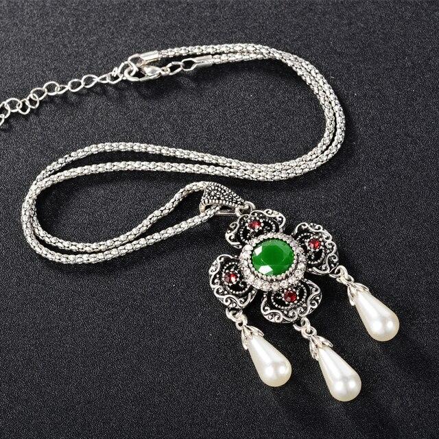 Фото ожерелье и серьги с африканским жемчугом свадебные золотые ювелирные цена