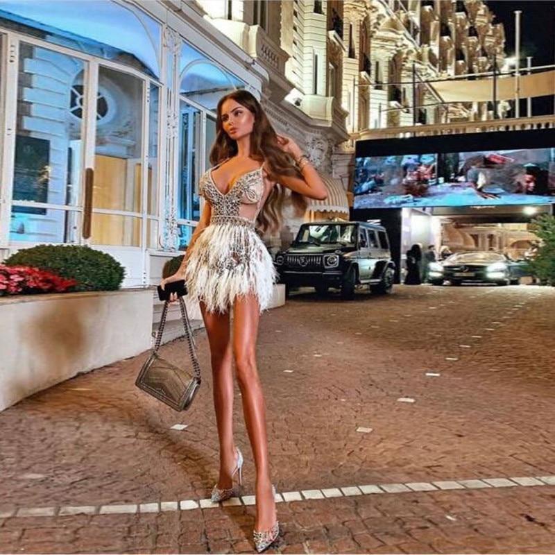 Sexy Spaghetti Strap Dubai Arabic Illusion Above Knee Evening Formal Dresses 2019 Chic Beading Feather Mini Prom Party Dresses