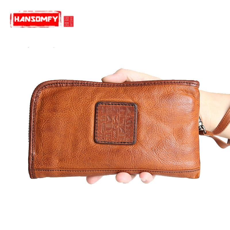 Men 's long wallet is the brand of the first layer of leather Purse leather zipper handbag large - capacity Vintage wallets 2017 hot high quality brand baotou layer of cow leather bags the new ms tassel handbag is a 100% leather handbag