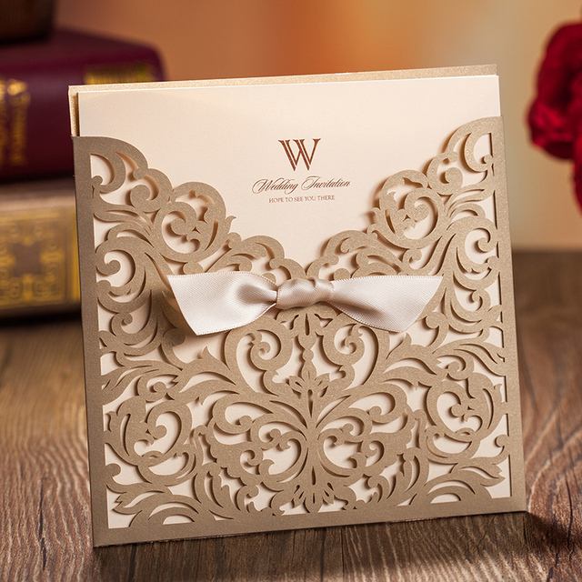 Aliexpress buy 10sets laser cut wedding invitations bow gold 10sets laser cut wedding invitations bow gold hollow invitation card for party supply free printing filmwisefo