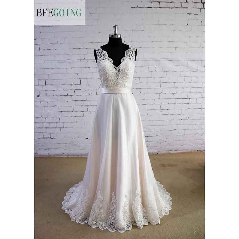 Ivory Tulle  Lace A-line  Floor-Length  V-Neck Wedding Dress  Sweep/Brush Train Sleeveless Real/Original Photos Custom Made