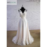 Ivory Tulle Lace A Line Floor Length V Neck Wedding Dress Sweep Brush Train Sleeveless Real