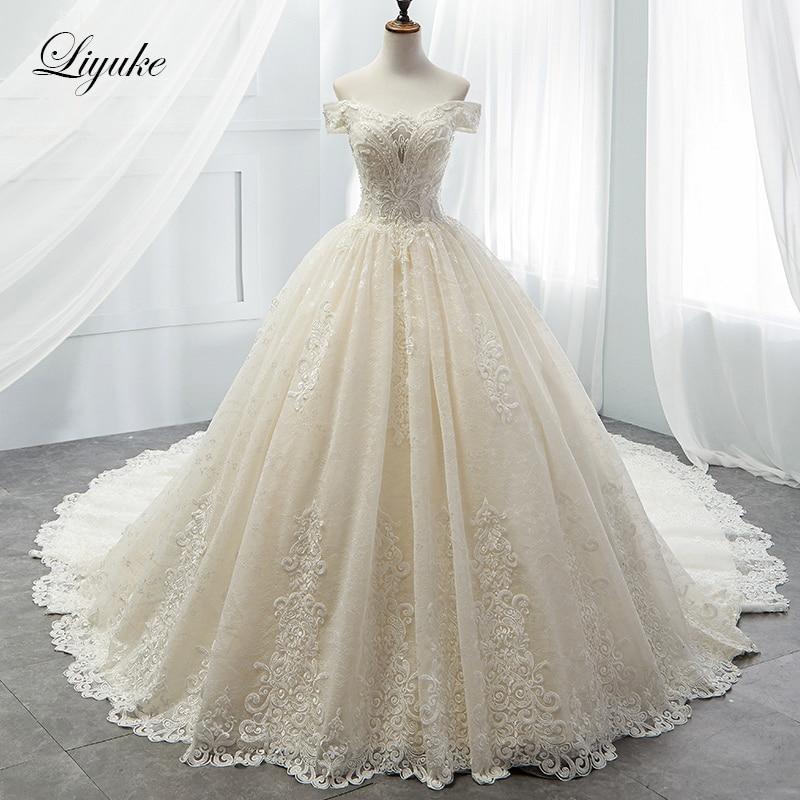 Liyuke Luxurious Princess Ball Gown Wedding Dress Strapless Elegant Beading Chapel Train Bridal Dress Vestido de