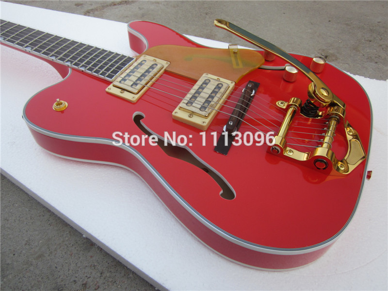 free shipping 2015 electric guitar with glod color big tremolo guitar in china in guitar from. Black Bedroom Furniture Sets. Home Design Ideas