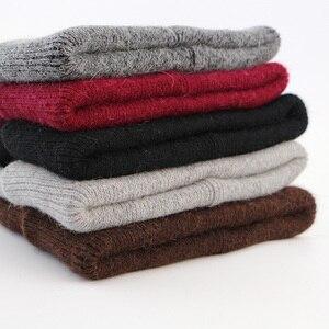 Image 4 - GZhilovingL الشتاء الشهيرة الدافئة الصوف قبعة حقيقية عادية Skullies قبعات منسوجة أرنب أسود لانا قبعات منسوجة الرجال الصوف قبعة سميكة