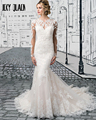 Joky Quaon Spring Autumn Appliques Lace Long Sleeves Wedding Gowns Slim Graceful White Mermaid Bride Dresses 2017 Vestidos Praia