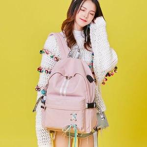 Image 5 - Tourya mochila feminina impermeável refletiva, mochila feminina impermeável e antirroubo com carregador usb, ideal para viagens e transportar laptops