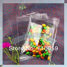 500pcs/lot 2size Small plastic bag (55x55mm 70x70mm) clear cello bags cookie bags(China (Mainland))