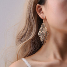 Hot-selling European and American fashion OL simple elegant gold silver multi-layer hollow Leaf Earrings Long