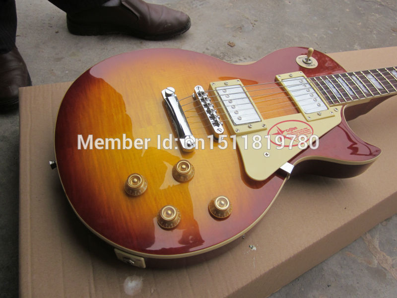 Free shipping 2014 Limited Yellow Ebony Guitarra Wholesale New Gib Standard/slash/oem Lp Guitar with Flame Top/guitar In China human free shipping new guitarra ricken