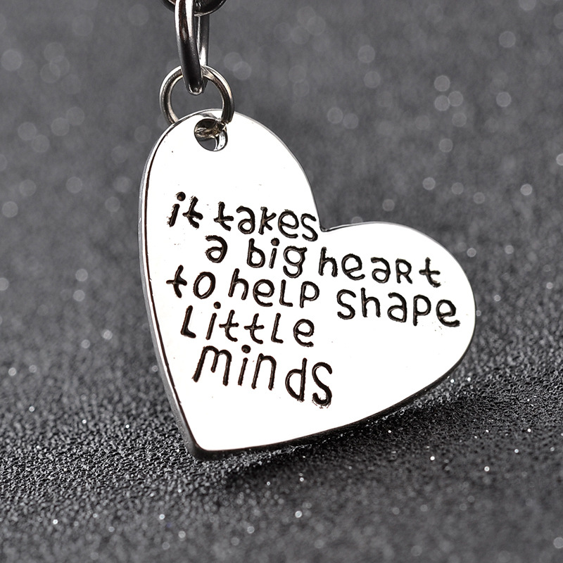 Heart Shaped Engravedit takes a big heart to help shape little minds Key Chain Gifts For Teacher Keychain Teachers Day