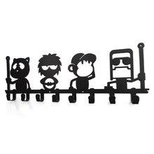 Cuatro al hombre sentado en el columpio de metal hierro Muebles para el Hogar creativo de la historieta ropa colgando decoración de la pared
