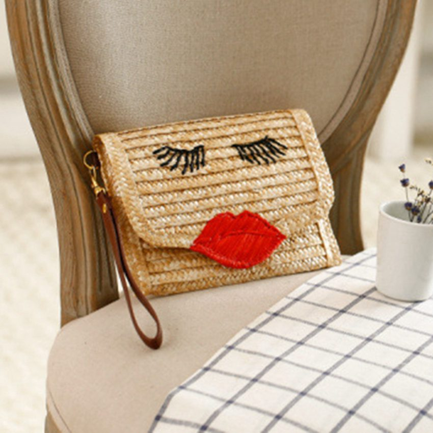 Korean version of the eyelashes curved smile hand bag knitting package red lips hand woven bag fashion holiday beach bag