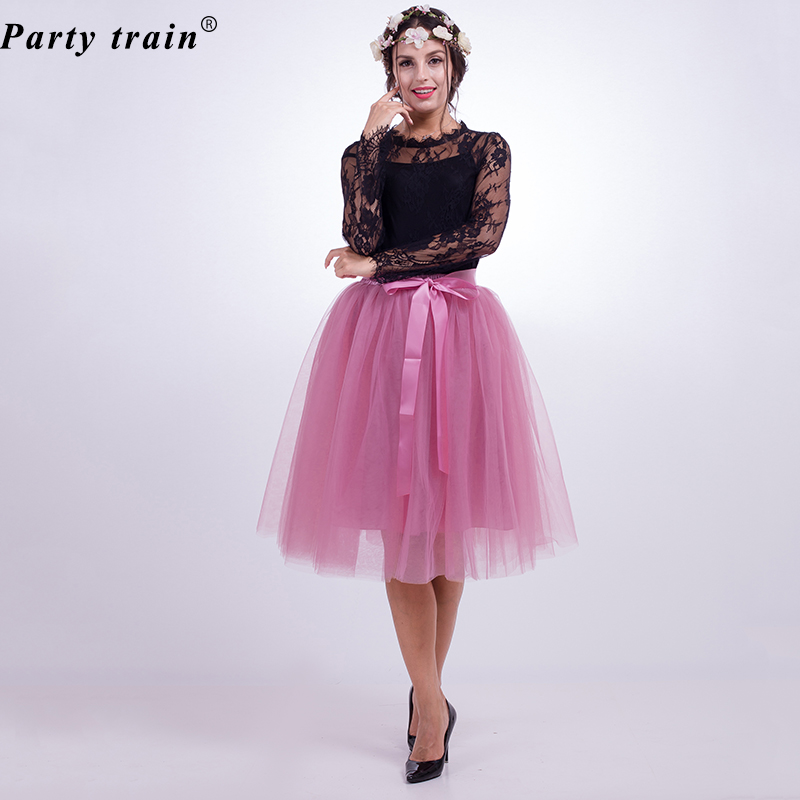 371dea22df Our tulle skirt features a satin waistline a flattering flitandflare cut