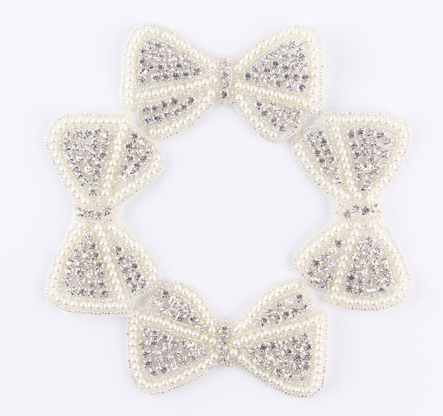 (60pcs lot)Wholesale Bows Shape Crystal Pearl Rhinestone Appliques Patch Sew  On Hot-Fix Beaded Motif Patch For Girl Dress Hair b602fd8ba895