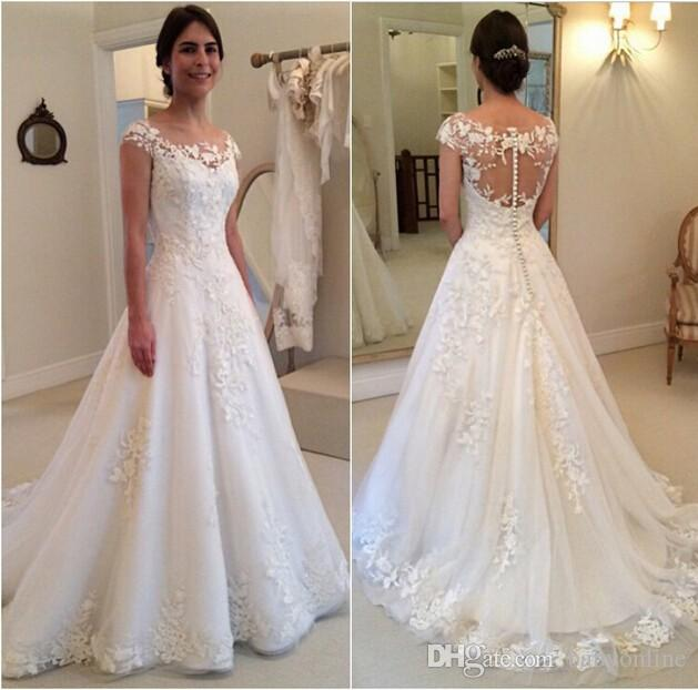 a74d1b1fda99 2016 Modest New Lace Appliques Wedding Dresses A line Sheer Bateau Neckline  See Through Button Back Bridal Gown Cap Sleeves Vest