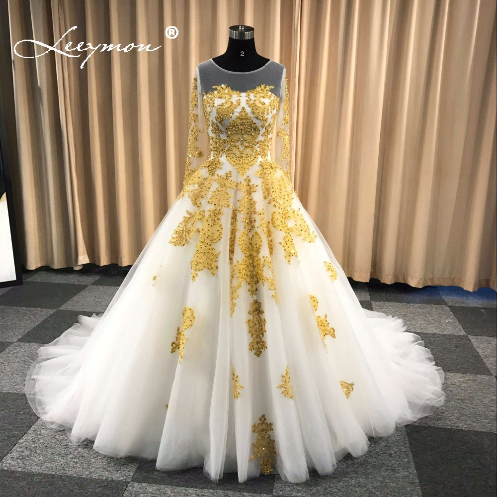 Leeymon Muslim Wedding Dress In Dubai White and Gold Long Sleeves Wedding Gown Beaded Lace Vestido De Noiva W46 貓 帳篷