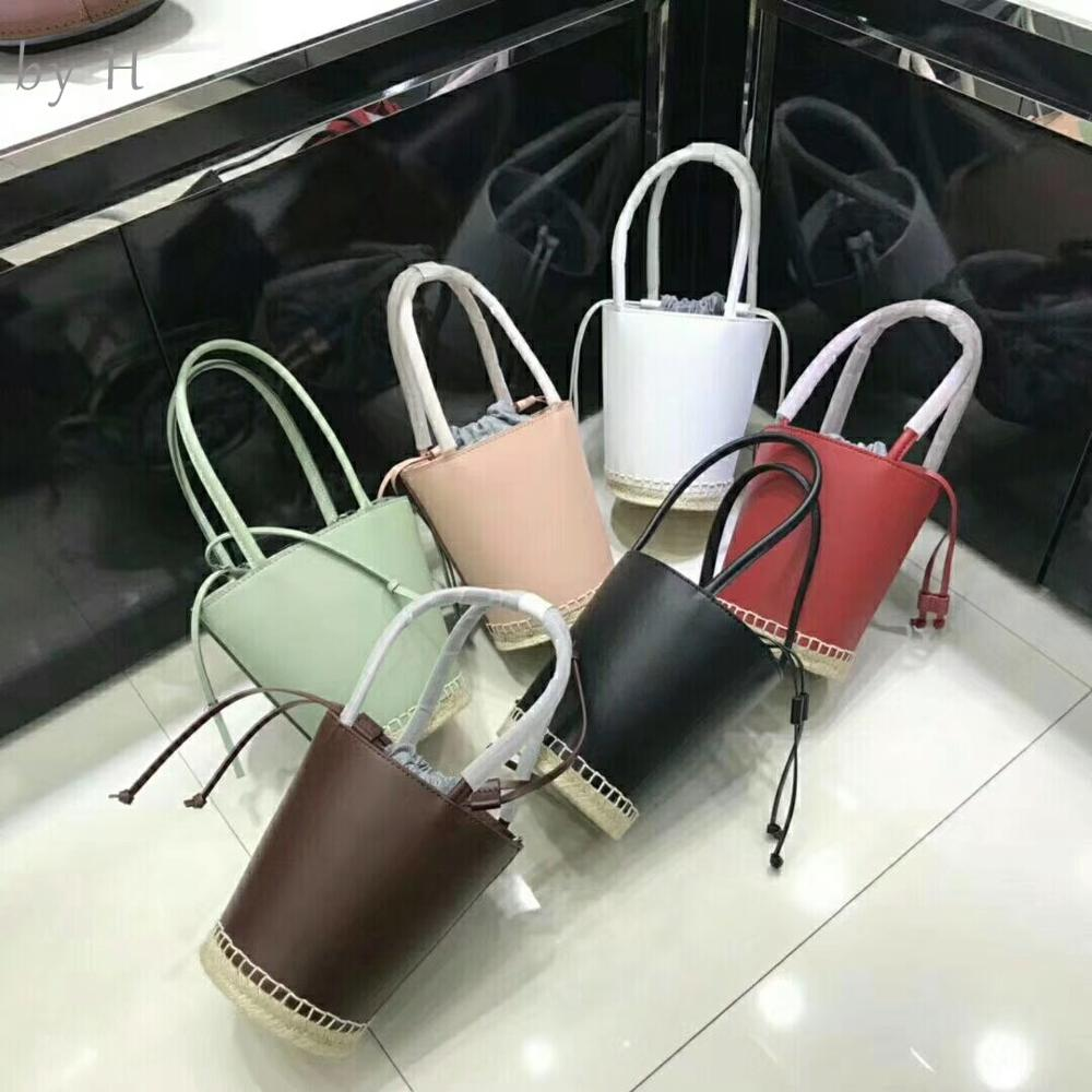 by H 2019 new high quality real leather womens bonsai luxury designers female shoulder bag straw briad bucket bag string bag
