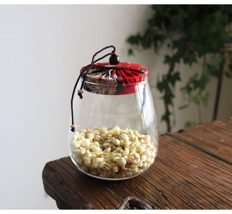 latas de chá de vidro transparente com