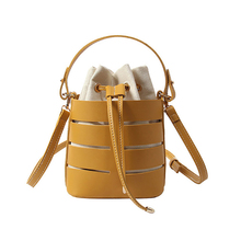 2018 New Tide Solid Color Hollow PU Material Small Fairy Bag Portable Bucket Bag Casual Wild Single Shoulder Messenger Bag wecayisa retro splicing rivet bucket bucket bag shoulder messenger bag new tide wild fashion black pink white 3color