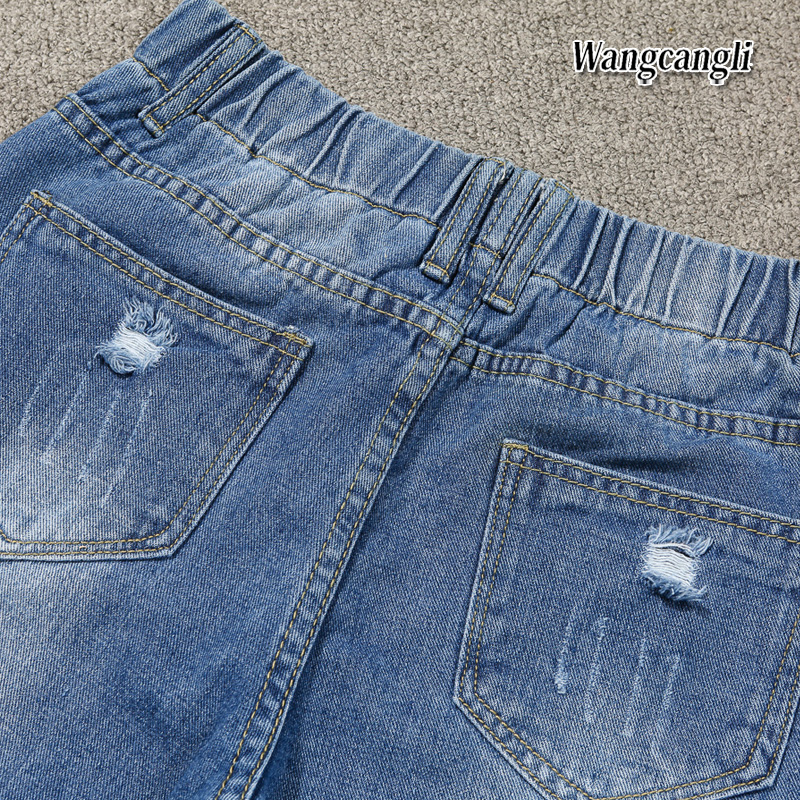 HTB1OsXygYSYBuNjSspfq6AZCpXak Fashion Large size women's denim nine pants 2018 spring and summer high waist hole 5XL Blue women's elastic feet pants 015#