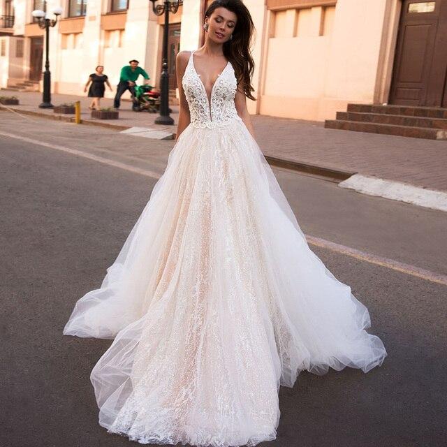 Błyszczą tiul koronka z koronki Vestido Noiva Praia głębokie V szyi koronki Vestido De Novia Desmontable luksusowe koraliki suknie ślubne turcja
