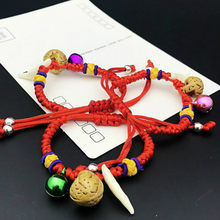 1pcs sell Baby The Newborn Charm Bracelets The Dog Tooth Peach Pit Bracelets The Bell Red Rope Hand Catenary(China)