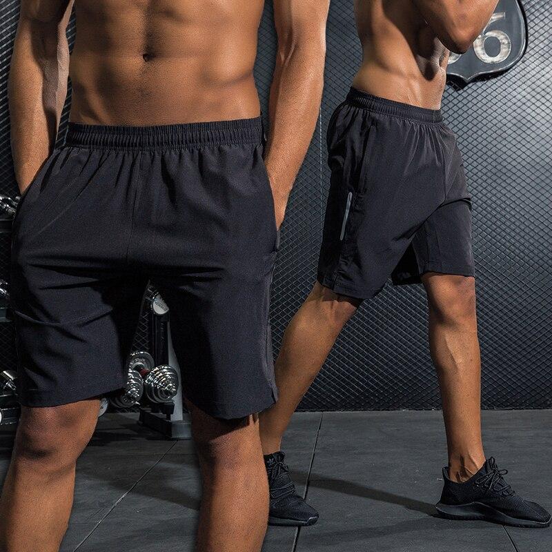 Pantalones cortos hombres corriendo rápido seco entrenamiento culturismo  gimnasio pantalones cortos de Spandex deportes Jogging 2018 bolsillo  directo ... 3f08035d546
