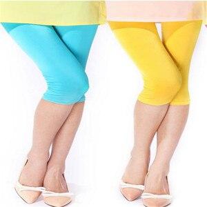 Image 4 - Nowe miękkie w jednolitym cukierkowym kolorze kobiety letnie legginsy wysokiej rozciągnięte wysokiej jakości odzież Fitness przycięte spodnie damskie akcesoria