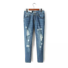 2016 women's aa fashion all-match hole denim trousers water wash casual pants skinny pants Broken hole casual jeans pencil pants