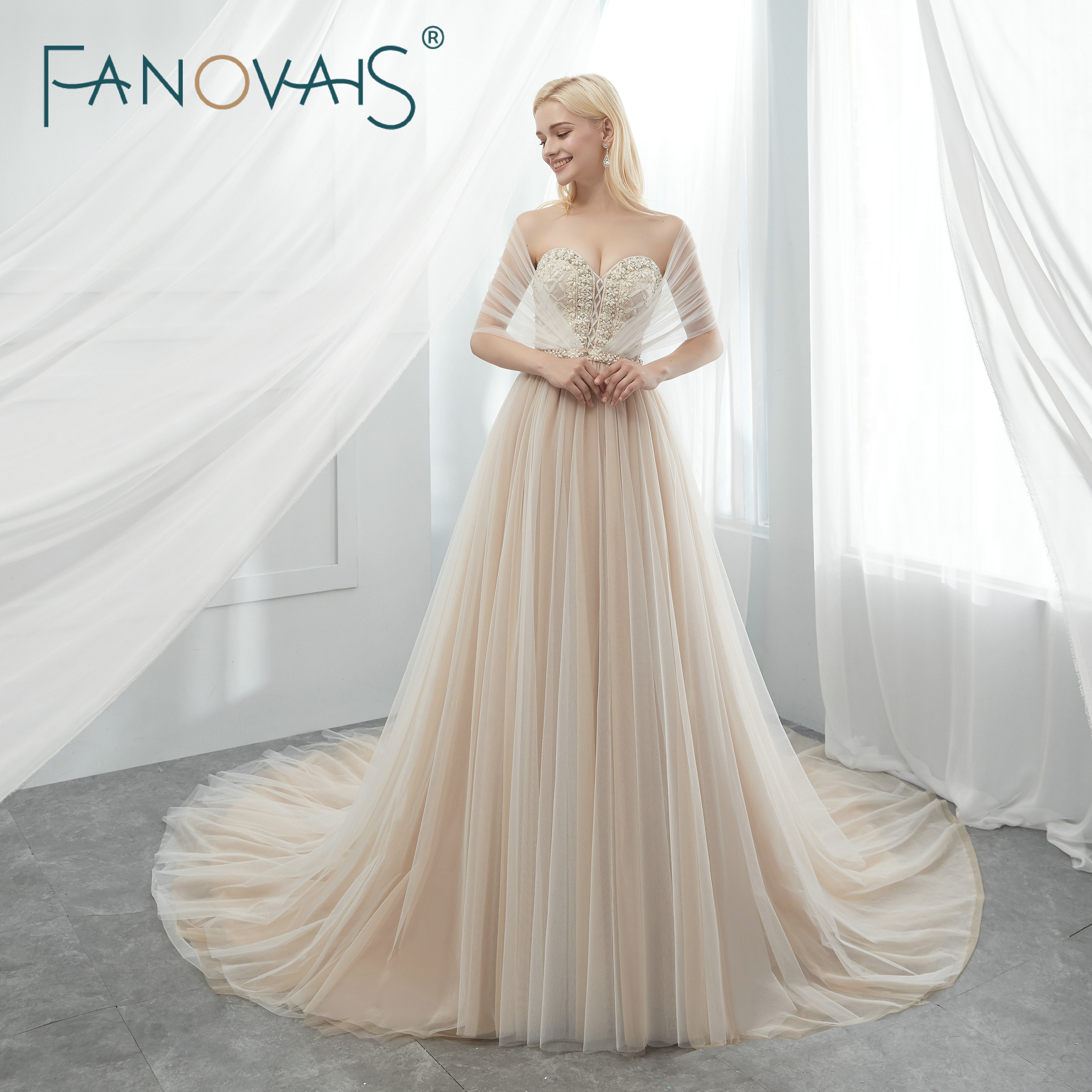 Tulle Wedding Dresses Beads BOHO Wedding Dress with Cape Champagne Bridal  Gowns Vestido De Novia Robe De Mariage 9e2aa3974b23