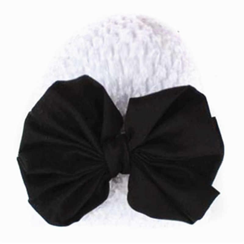 Nuevo suave de alta calidad niños pequeños lindos niños niña Bowknot ahueca hacia fuera sombrero Skullies gorros para el invierno mejor venta