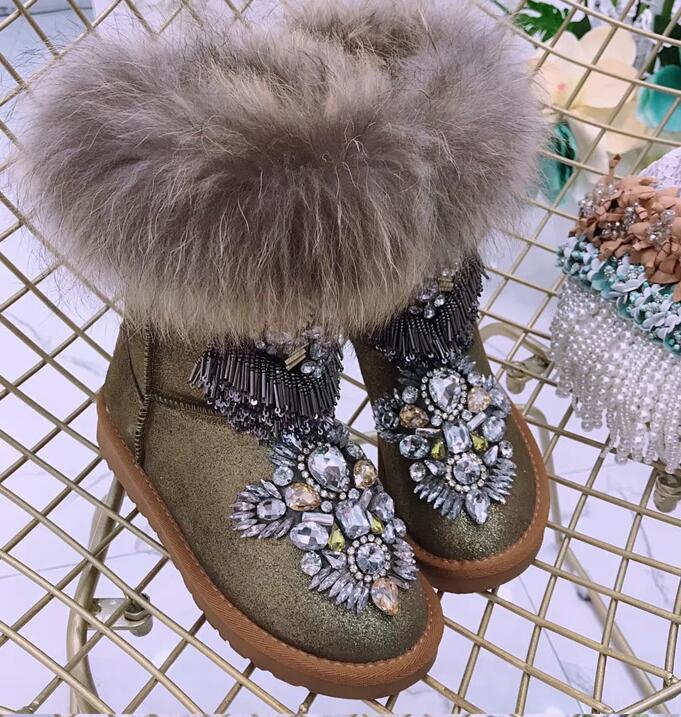Tige en cuir à texture métallique exquise avec pompon en diamant autrichien bottes en fourrure de raton laveur perlées