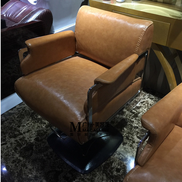 Hairdressing chair. Beauty salon lang special barber chair. Hydraulic haircut chair