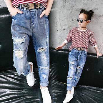 b3c4a6078 Niños Jeans Wear Skinny Jeans bebé niña otoño invierno largo roto pantalón  Botón de moda Denim Pantalones de los niños pantalones vaqueros para las  niñas