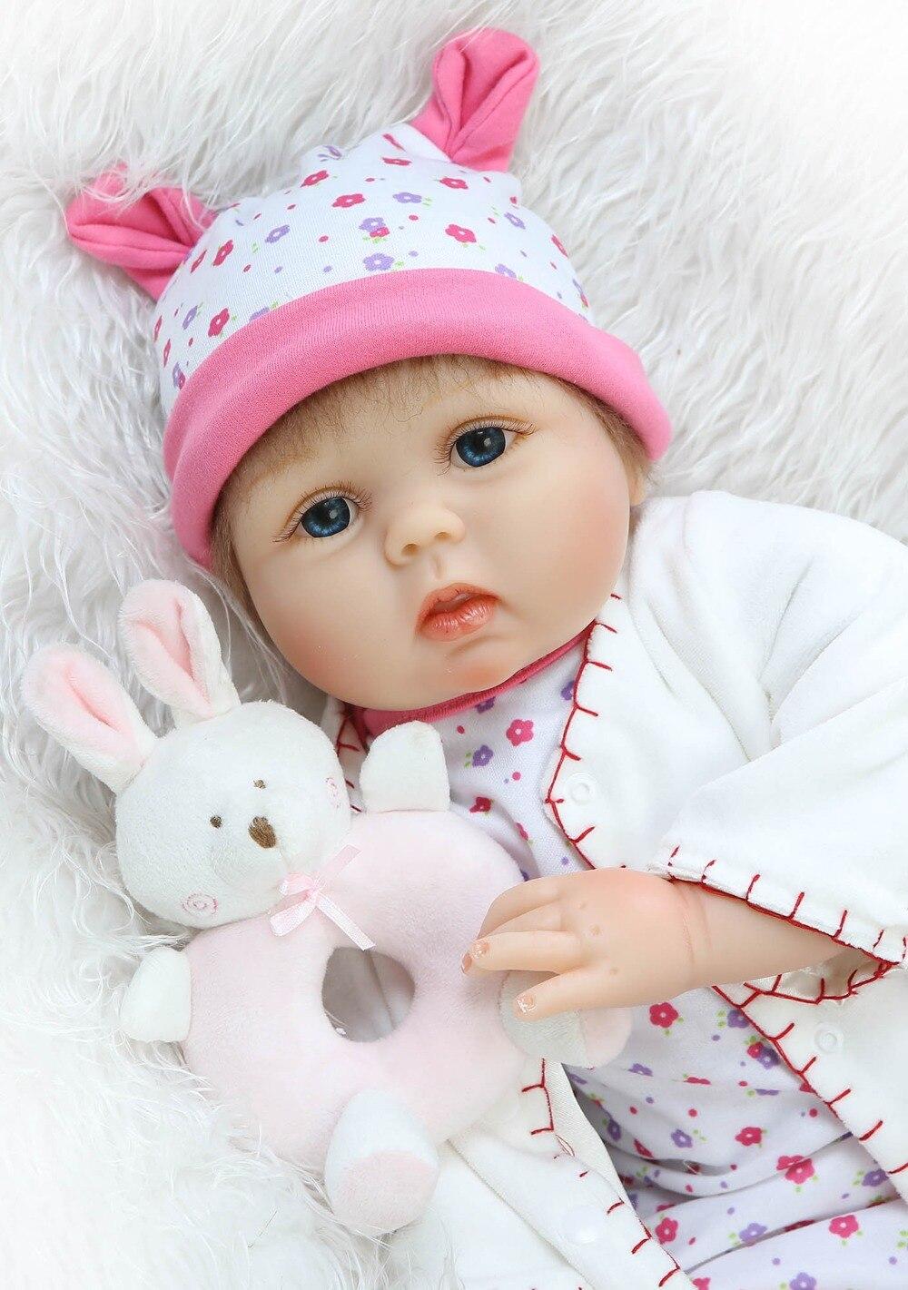 Neues design 55 cm weichem silikon reborn baby doll wurzel mohair puppe mit schmetterling spielen spielzeug für kinder Weihnachten süße baby-in Puppen aus Spielzeug und Hobbys bei  Gruppe 1